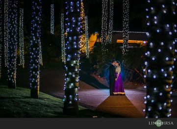 This night shot is so romantic with the twinkle lights in the background.
