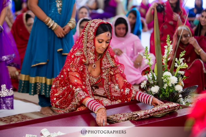 Indian Punjabi Sikh wedding ceremony at the Gurdwara, featured on ShaadiShop