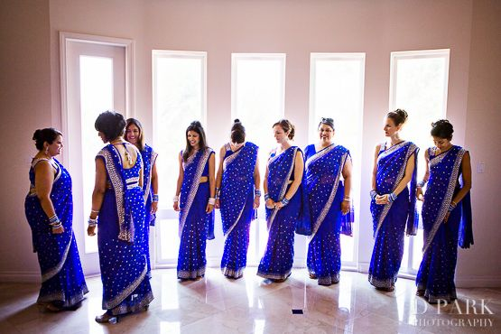 Bridesmaids huddlling for a photo session before the Hindu wedding ceremony starts