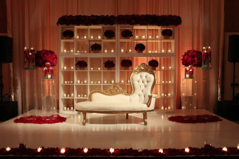 What an elegant sweetheart table and stage for the bride and groom.