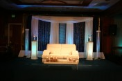 Close up of the stage and sweetheart table for the bride and groom.