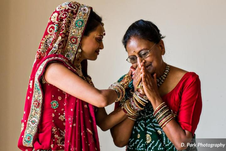 The bride sharing an emotiional moment with her mother