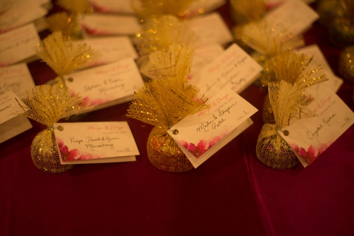 The escort cards were handwritten and had a little treat attached.