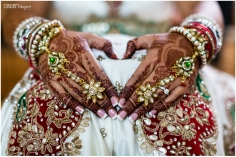 An Indian bride's with beautiful, dark mehndi and panja