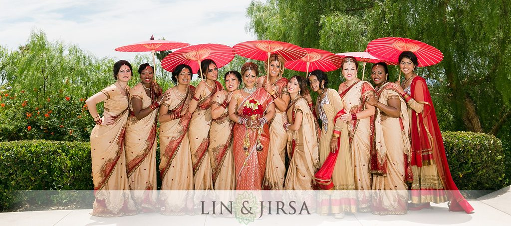 Outdoor Indian wedding at the Newport Beach Marriott Hotel and Spa in the Rose Garden. An Indian bride in a photo with her bridesmaids wearing matching saris.