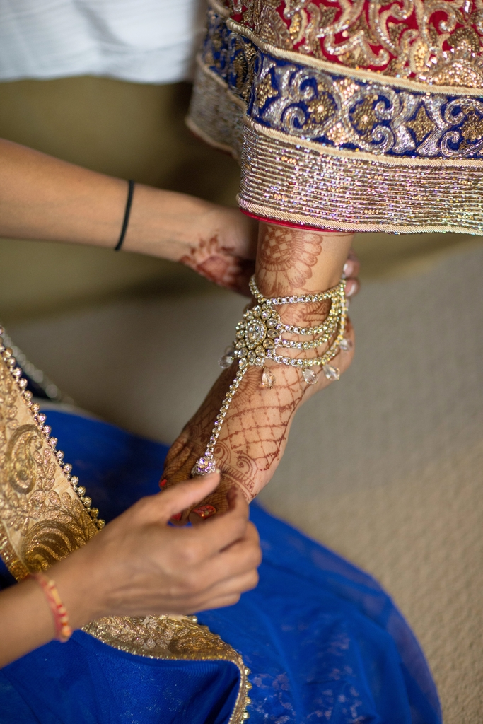 An Indian bride's foot showing her mehndi and payal on her feet.