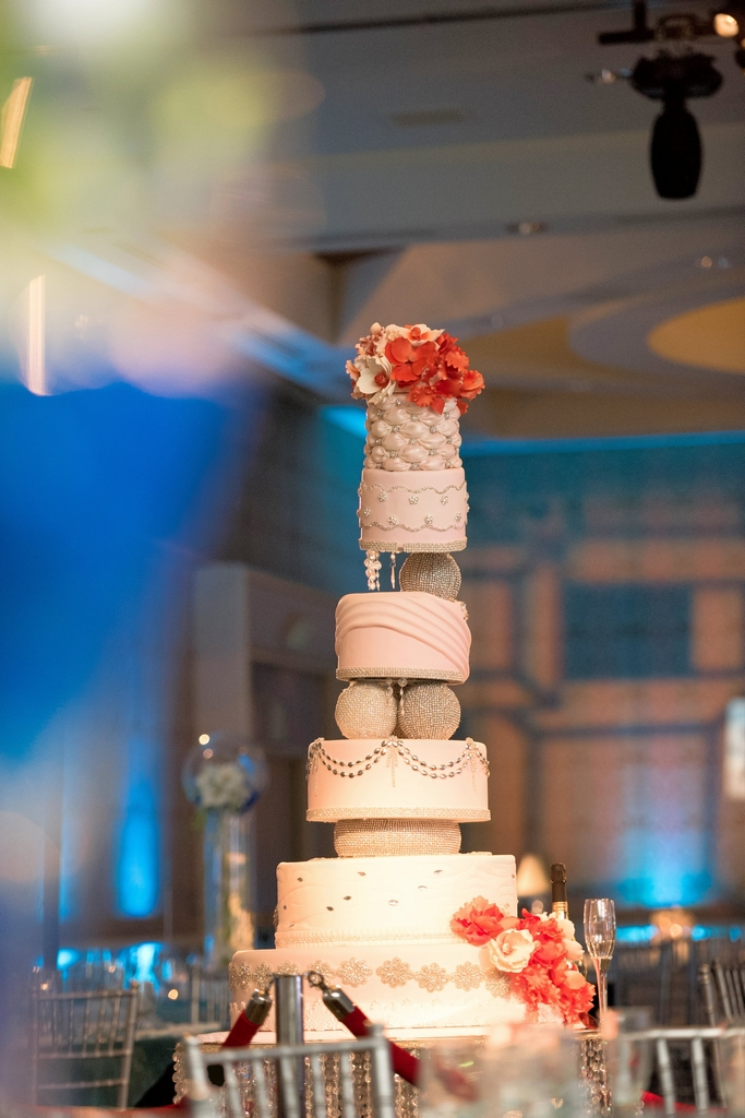 Extravagant Indian wedding with a custom-made 9 foot wedding cake used in the ballroom after the Hindu wedding ceremony.