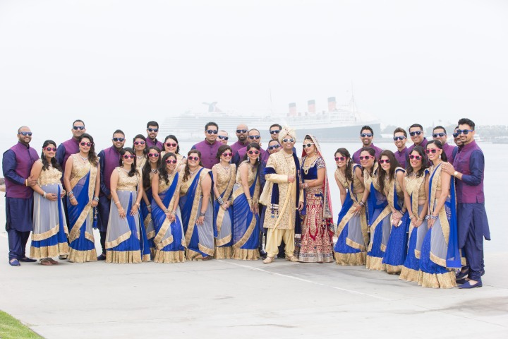 The briadl party at an Indian wedding posing for a photo with everyone wearing sunglasses