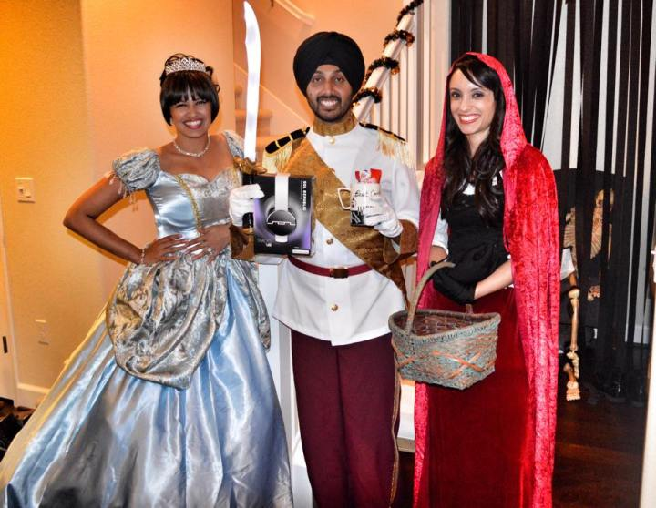 Poonam and Kiranjit dressed as Cinderella and Prince Charming for Halloween.