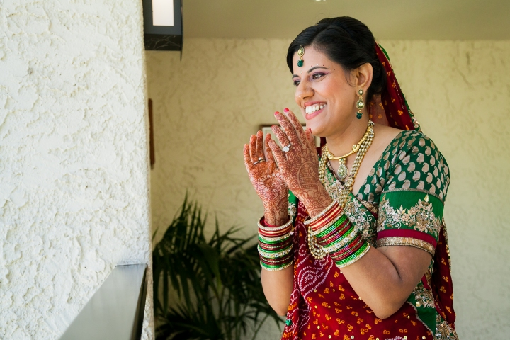 Newport-Beach-Marriott-Indian-Wedding-bride-watching-baraat-balcony
