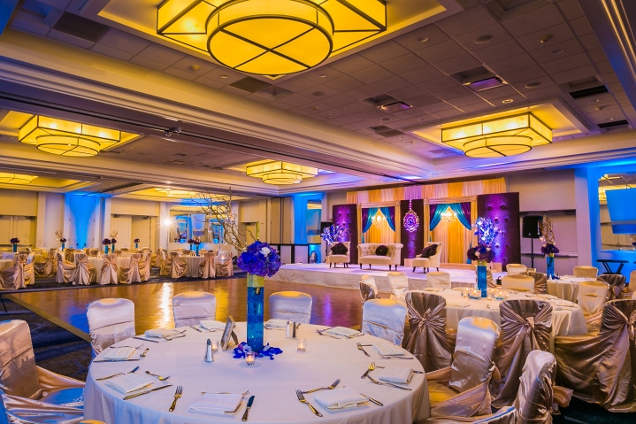 the banquet tables setup for a wedding reception at the Newport Beach Marriott Hotel and Spa