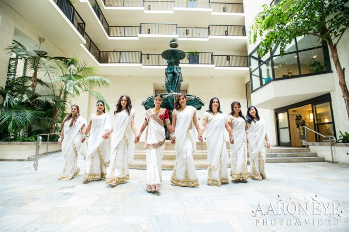 Reha-Vijay-Newport-Beach-Marriott-South-Asian-wedding-Indian_wedding-Hindu-Jain-North_Indian-head-table-ballroom-Aaron-Eye-Photography-bridesmaids-saris