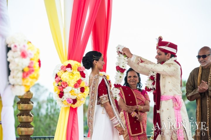 Reha-Vijay-Newport-Beach-Marriott-South-Asian-wedding-Indian_wedding-Hindu-Jain-North_Indian-head-table-ballroom-Aaron-Eye-Photography-varmala-bride