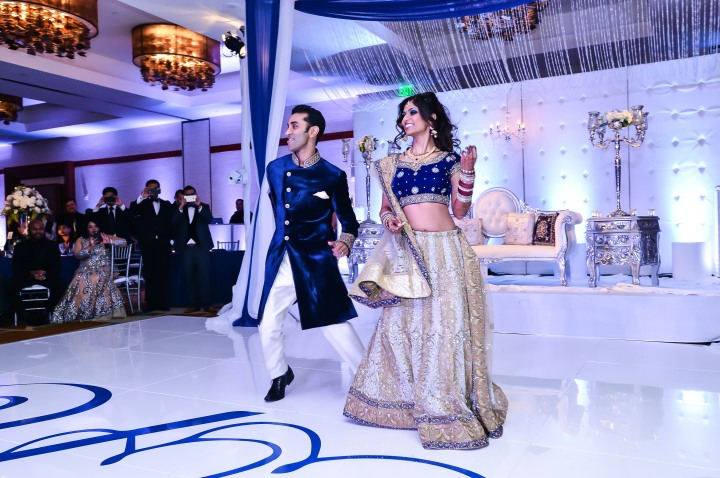 Indian bride and groom dancing together at their wedding reception