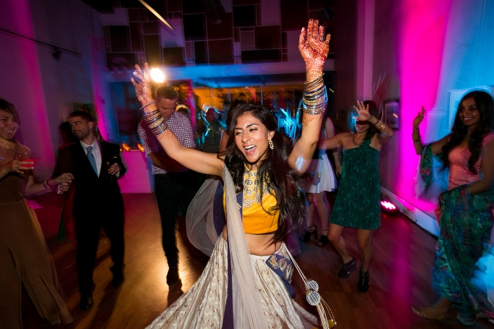 Bride dancing at sangeet night for Indian wedding