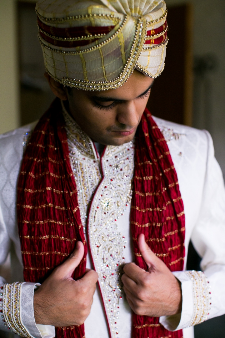 Groom getting ready for Indian wedding