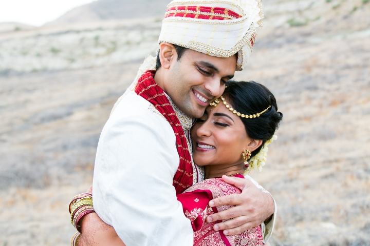 Indian bride and groom at sangeet for an Indian wedding