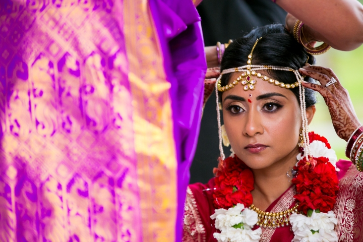 Bride wearing tikka and bindi, gajra and sari for Hindu, Indian wedding and mundalviya