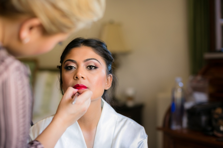 Indian bride getting ready for her Hindu wedding ceremony. Lulu from Dolled Up By Lulu is getting her ready.