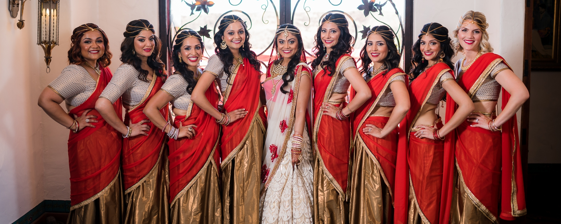 Red And Gold Bridesmaids Saris Indian Wedding Venues
