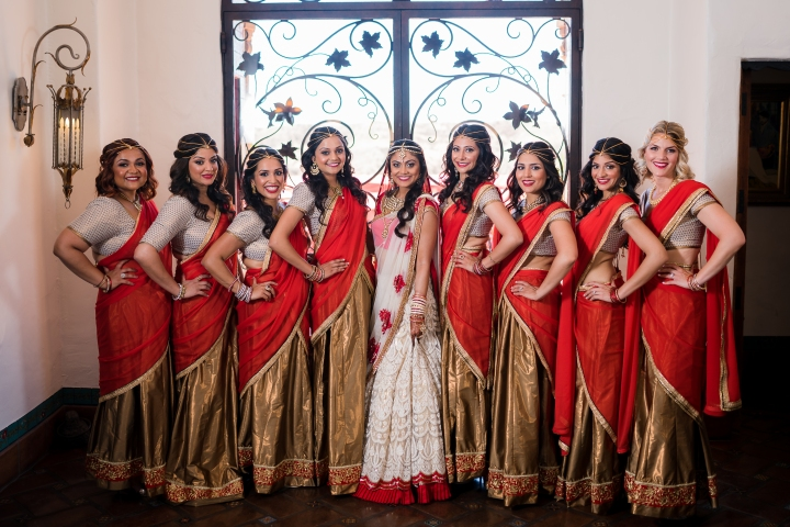 Indian bride with her bridesmaids wearing lehega designed and made by the bride in Mumbai.