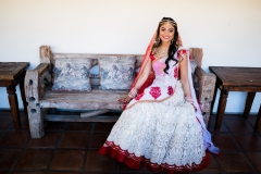 The Indian bride, dulhan, wearing her wedding lehenga. Gujarati brides often wear a mix of red and white for their Hindu wedding.