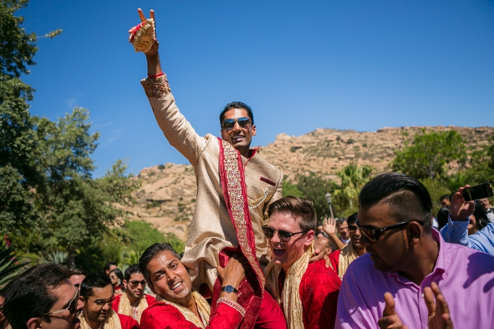 Indian Gujarati groom dancing at his baraat.