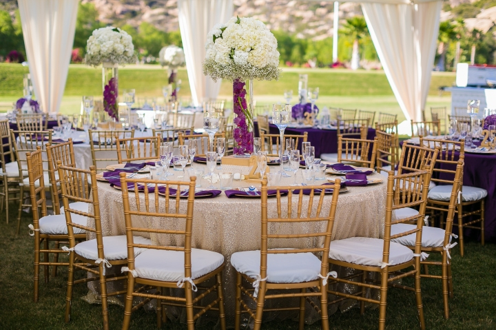 gold chiavari chairs at Indian wedding reception