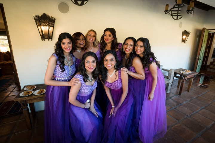 Bridesmaids Wearing Purple Gowns At An Indian Wedding Reception