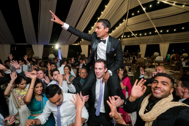 Indian groom dancing the night away at his wedding reception.