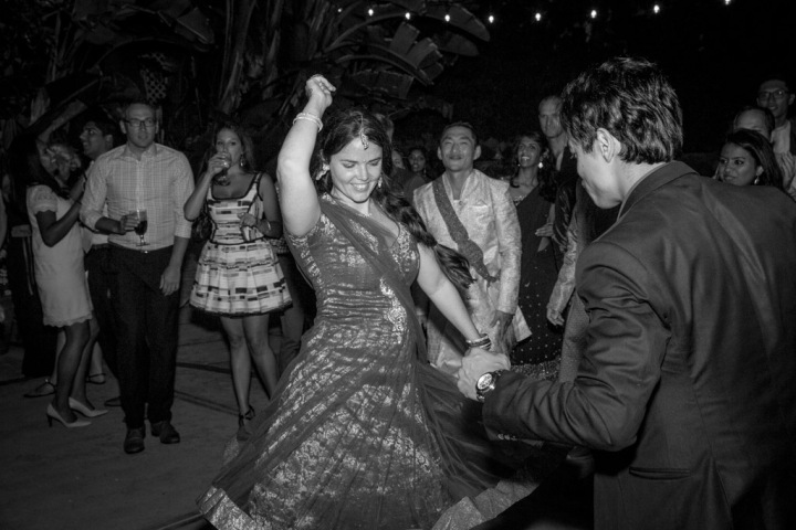 Guests dancing at an outdoor Indian wedding reception