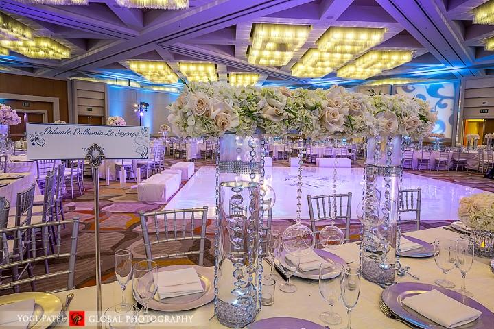 Indian-wedding-pink-lehenga-sherwani-sera-Hotel-Irvine-dupatta-Global-Photography-Kunal-Shveta-chiavari-chairs-reception