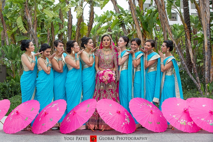 Indian wedding bridal party with pink umbrellas