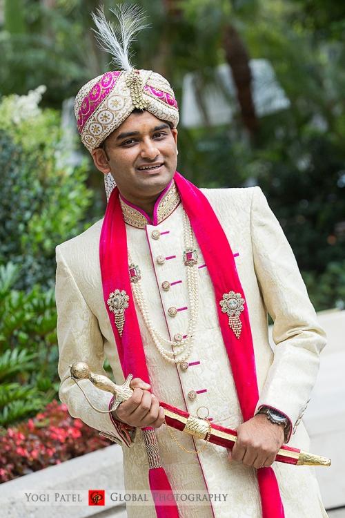 Punjabi groom holding talwar for his Indian wedding ceremony