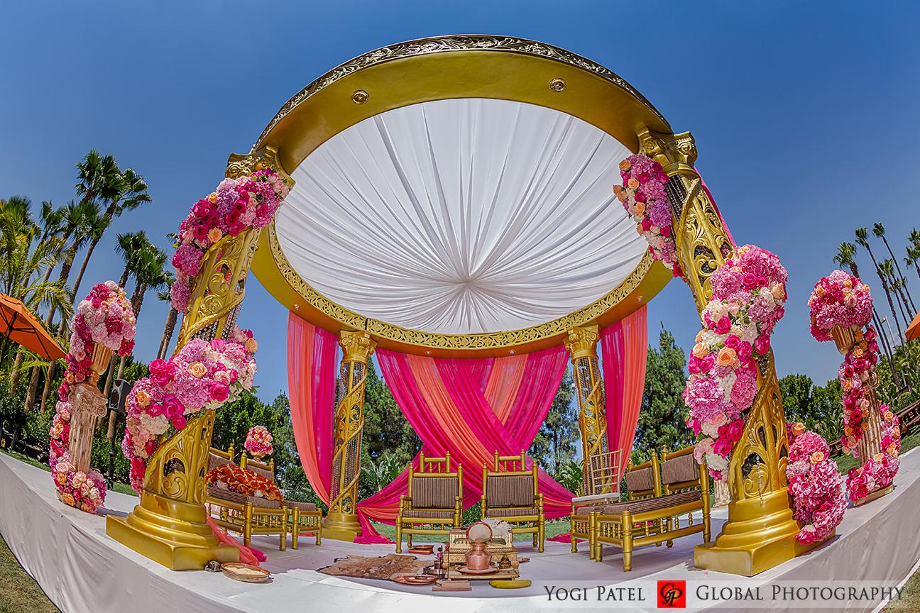 Pink mandap for an outdoor Indian wedding