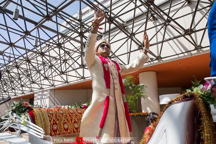 Groom dancing in the baraat of his Indian wedding.