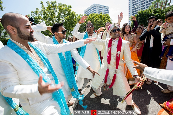 Indian Jain Punjabi wedding ceremony at Hotel Irvine with groomsmen dancing in the baraat.
