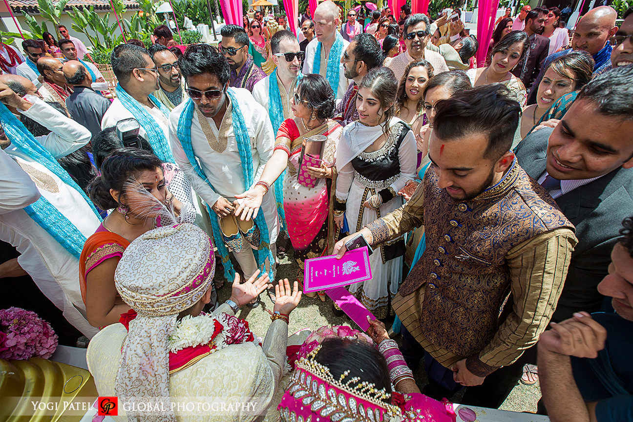 The Indian groom negotiating to get his shoes back at his Indian wedding