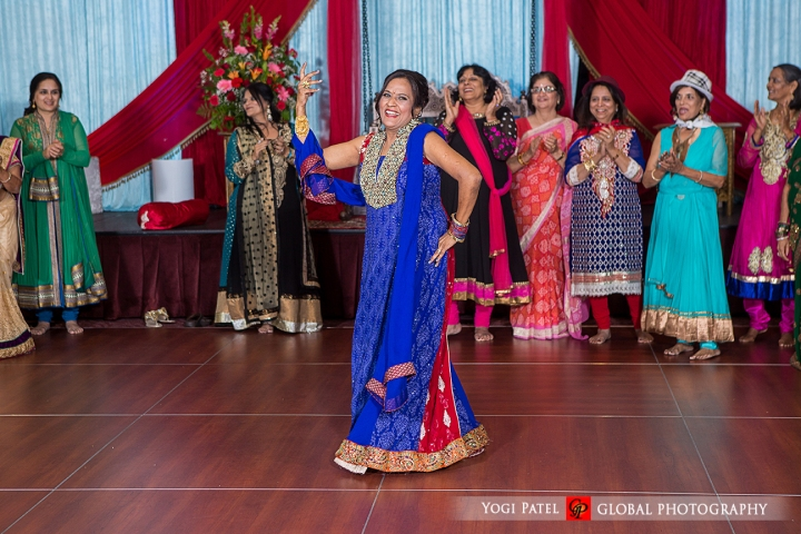 Groom's mom dancing at the sangeet for the Indian wedding.