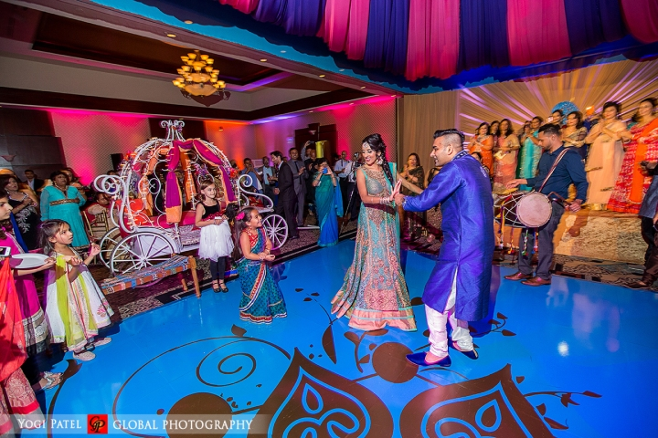 Indian wedding sangeet with bright decor and blue dance floor