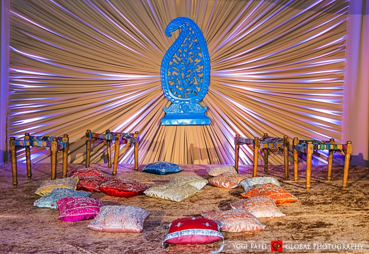 Punjabi Jain Indian wedding sangeet pillows and paisley background decor