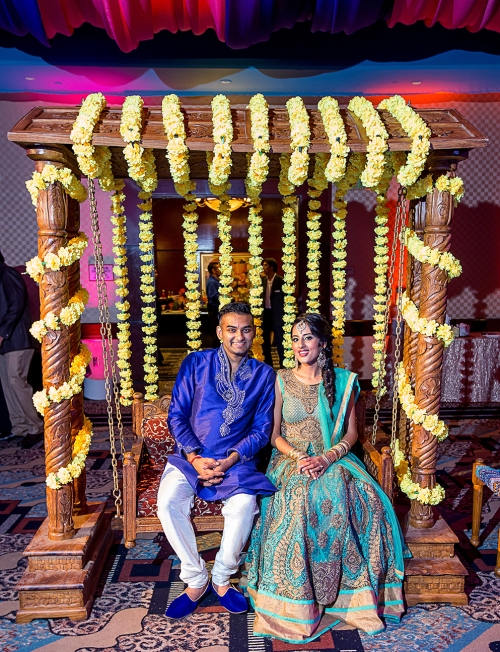 The bride and groom at their Indian wedding sangeet