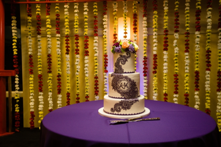 Indian wedding reception. The bride and groom's beautiful cake after the Hindu wedding ceremony.