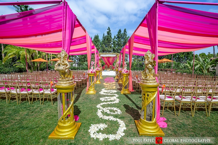 Shveta-bride-groom-Hotel-Irvine-Global-Photography-sherwani-lehenga-bollywood-dance-Hindu-wedding-ceremony-jaimala-varmala-mandap-chiavari-chairs-pink-canopy-pink-programs