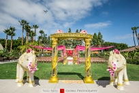 Indian wedding at Hotel Irvine with elephant statues and an arch for the milni.