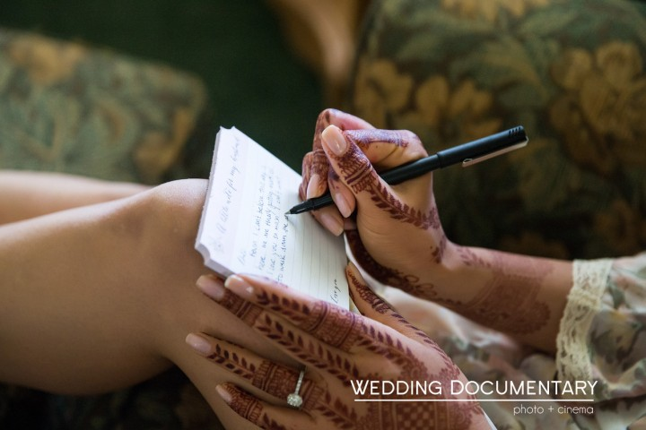 Bride writing a love note to her groom, the morning of her wedding.