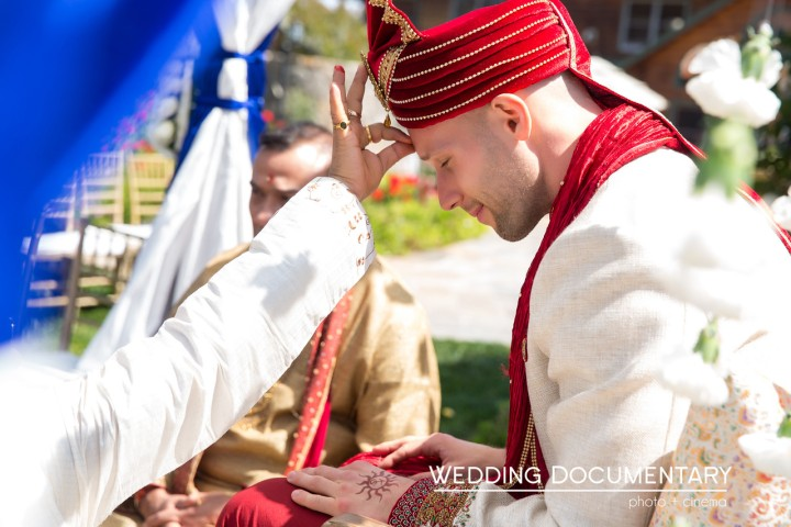 Groom wearing sherwani and sehra entering the mandap for his Hindu wedding ceremony.