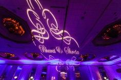 A gobo of the bride and groom's names at their wedding reception.