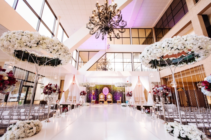 A white runway instead of an aisle for an Indian, Hindu wedding ceremony.