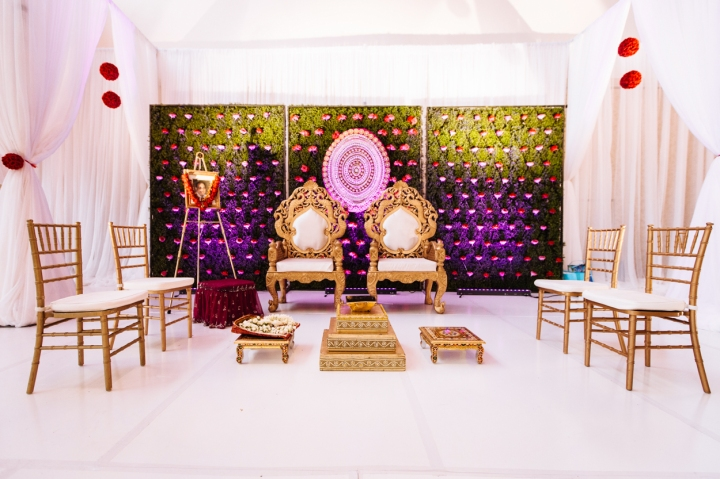 Backdrop and chairs setup on a runway for a mandap for an Indian, Hindu wedding ceremony.
